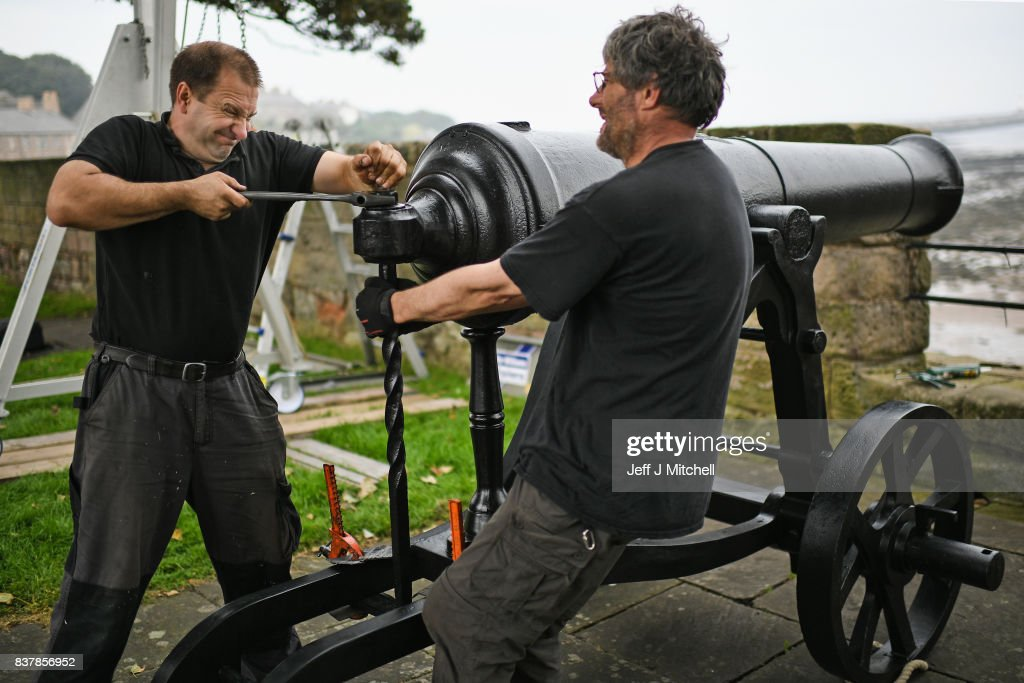 Tim Martin and Mathew Packer place a restored canon captured at Sebastapol in 1856 onto the town walls on August 23, 2017 in Berwick-upon-Tweed, England.English Heritage's only Russian cannon, made in 1826, returns to Berwick after extensive restorative works. Gifted to the town of Berwick in 1858 as a trophy of the Crimean War, it has since been preserved as a key historical artefact. The recent conservation works will protect the cannon from harsh coastal weather conditions, keeping it preserved for future generations and continuing its long tradition of care.