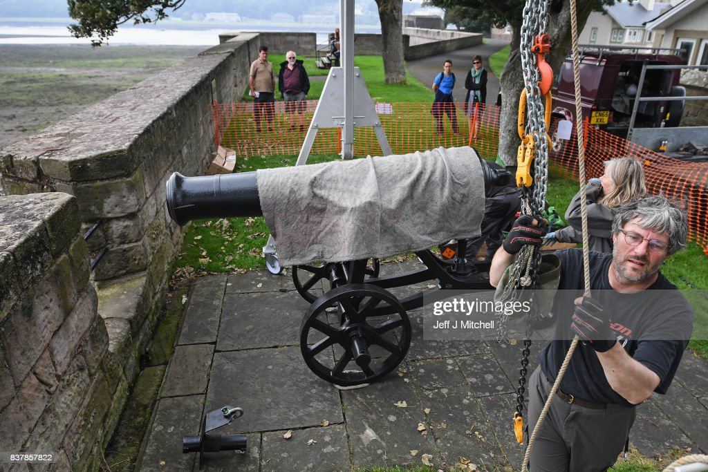 Tim Martin, Mathew Packer and Leesa Vere Stevens place a restored canon captured at Sebastapol in 1856 onto the town walls on August 23, 2017 in Berwick-upon-Tweed, England.English Heritage's only Russian cannon, made in 1826, returns to Berwick after extensive restorative works. Gifted to the town of Berwick in 1858 as a trophy of the Crimean War, it has since been preserved as a key historical artefact. The recent conservation works will protect the cannon from harsh coastal weather conditions, keeping it preserved for future generations and continuing its long tradition of care.