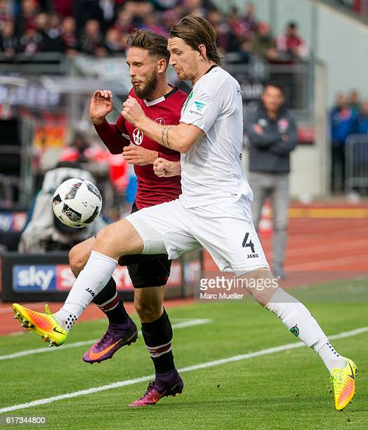 Tim Matavz of 1 FC Nuernberg challenges Stefan Strandberg of Hannover 96 during the Second Bundesliga match between 1 FC Nuernberg and Hannover 96 at...