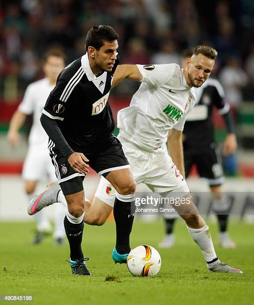 Tim Matavz of Augsburg vies with Fabricio of Partizan during the UEFA Europa League group L football match FC Ausburg vs FK Partizan at WWK Arena on...