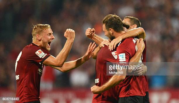 Tim Matavz of Nuernberg celebrates with teammates after scoring his team's first goal during the Second Bundesliga match between 1 FC Nuernberg and...