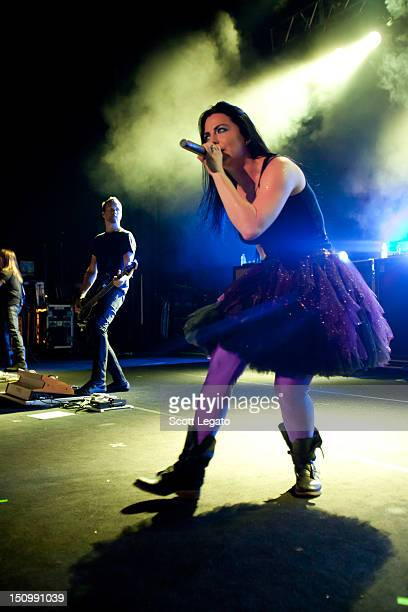 Tim McCord and Amy Lee of Evanescence perform during the Carnival of Madness tour 2012 at DTE Energy Music Theater on August 24 2012 in Clarkston...