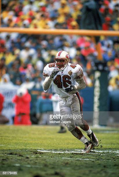 Tim McDonald of the San Francisco 49ers looks to make a play against the Green Bay Packers during the 1996 NFC Divisional Playoff game at Lambeau...