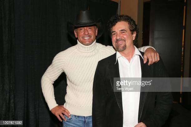 Tim McGraw and CEO of Big Machine Scott Borchetta backstage after announcing Tim McGraw's return to Big Machine Records at Omni Hotel on February 21,...