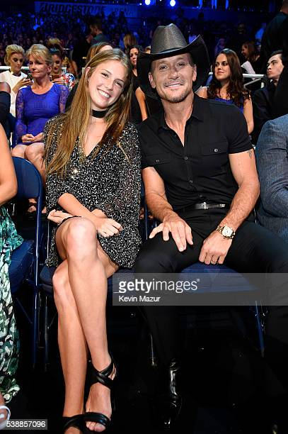 Tim McGraw and daughter attend the 2016 CMT Music awards at the Bridgestone Arena on June 8 2016 in Nashville Tennessee