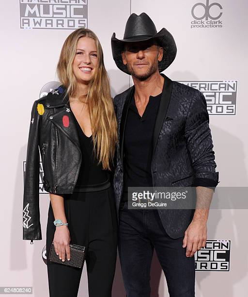 Tim McGraw and daughter Maggie McGraw arrive at the 2016 American Music Awards at Microsoft Theater on November 20 2016 in Los Angeles California