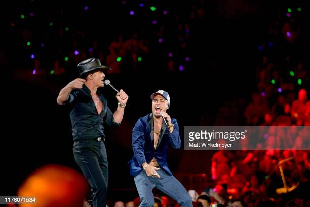 Tim McGraw and DJ Envy perform onstage during the 2019 iHeartRadio Music Festival at TMobile Arena on September 20 2019 in Las Vegas Nevada