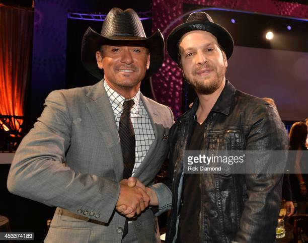 Tim McGraw and Gavin Degraw attend CMT Artists Of The Year 2013 at Music City Center on December 3 2013 in Nashville Tennessee