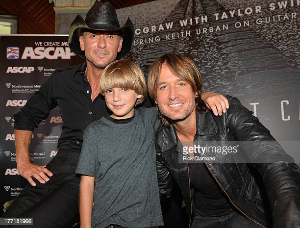 Tim McGraw and Keith Urban along with a young fan attend as Tim McGraw Celebrates MultiWeek No 1 Highway Don't Care at Music City Tippler on August...