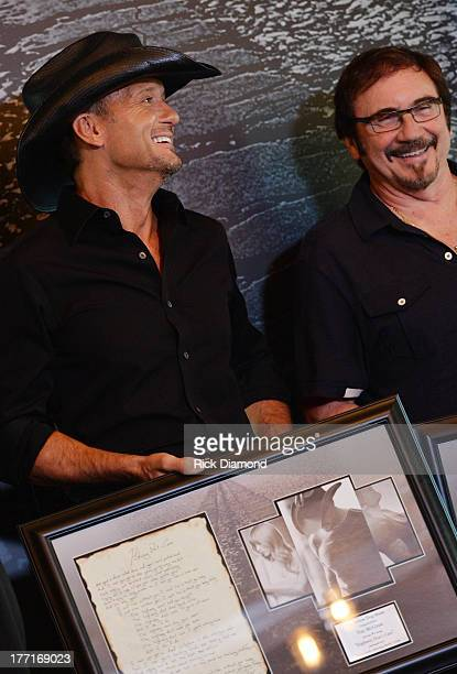Tim McGraw and producer Byron Gallimore Celebrate Tim McGraw's MultiWeek No 1 Highway Don't Care at Music City Tippler on August 20 2013 in Nashville...