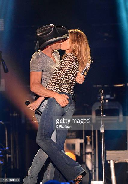 Tim McGraw and wife Faith Hill kiss onstage during the 2014 CMA Festival at LP Field on June 5 2014 in Nashville Tennessee