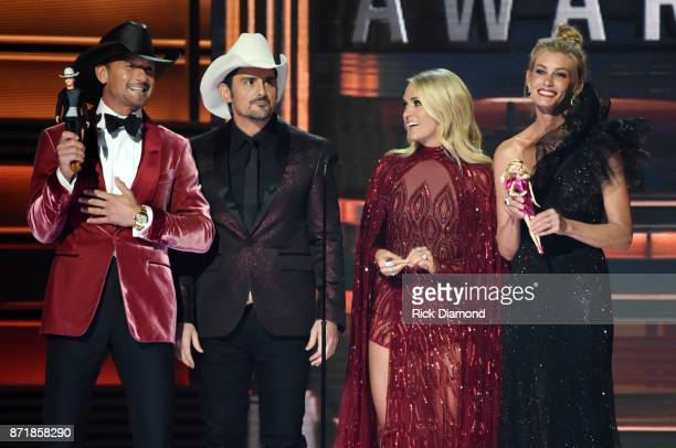 Tim McGraw Brad Paisley Carrie Underwood and Faith Hill speak onstage at the 51st annual CMA Awards at the Bridgestone Arena on November 8 2017 in...