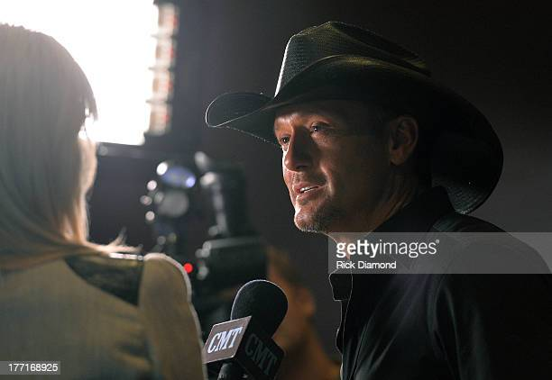 Tim McGraw Celebrates MultiWeek No 1 Highway Don't Care at Music City Tippler on August 20 2013 in Nashville City