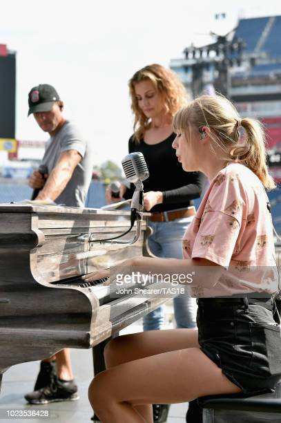 Tim McGraw Faith Hill and Taylor Swift take photos during rehearsal onstage before the reputation Stadium Tour at Nissan Stadium on August 25 2018 in...