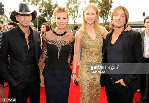 Tim McGraw Faith Hill Nicole Kidman and Keith Urban attend the 55th Annual GRAMMY Awards at STAPLES Center on February 10 2013 in Los Angeles...