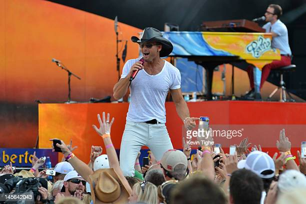 Tim McGraw performs during Kenny Chesney and Tim McGraw 'Brothers of the Sun' Tour KickOff Concert at Raymond James Stadium on June 2 2012 in Tampa...