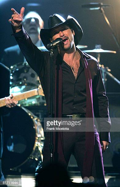 Tim McGraw performs on stage at the 38th Annual CMA Awards at the Grand Ole Opry House November 9 2004 in Nashville Tennessee