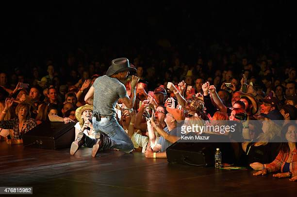 """Tim McGraw performs onstage during his """"Shotgun Rider"""" tour at Nikon at Jones Beach Theater on June 11, 2015 in Wantagh, New York."""