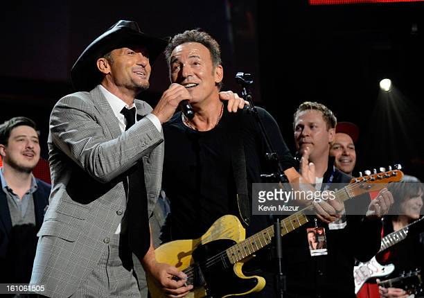 Tim McGraw performs with Bruce Springsteen at MusiCares Person Of The Year Honoring Bruce Springsteen at Los Angeles Convention Center on February 8...