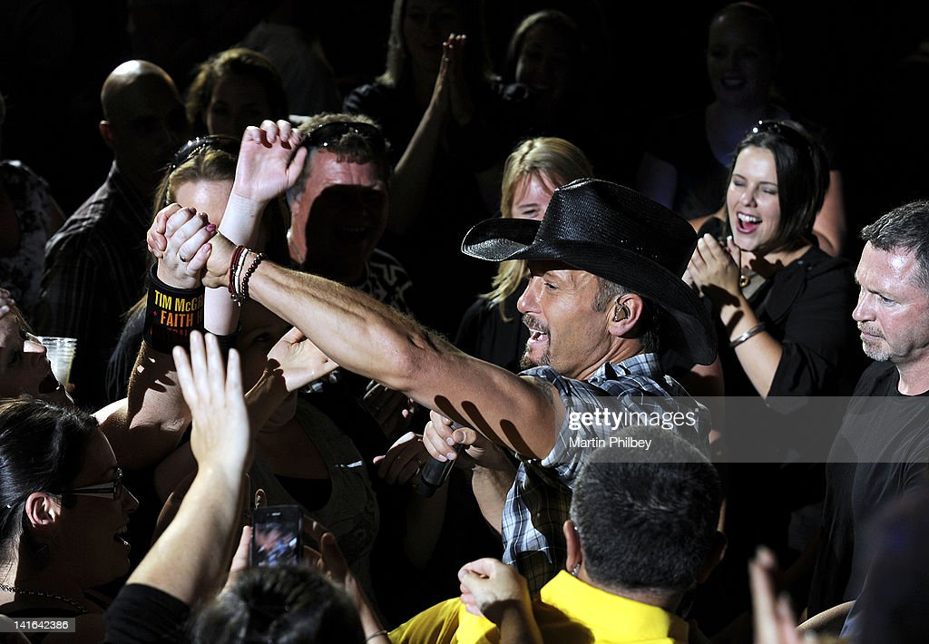Tim McGraw sings from the crowd in concert at the Rod Laver Arena on March 20, 2012, in Melbourne, Australia.