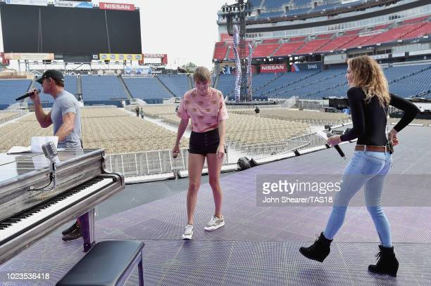 Tim McGraw Taylor Swift and Faith Hill take photos during rehearsal onstage before the reputation Stadium Tour at Nissan Stadium on August 25 2018 in...