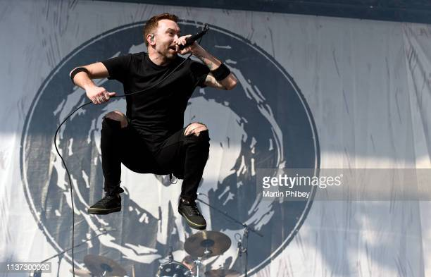 Tim McIlrath of Rise Against jumps in the air while perfomring on stage at the Download Festival on 11th March 2019 in Melbourne Australia