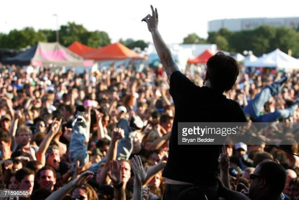 Tim McIlrath of the band Rise Against performs live on stage at the Vans Warped Tour on August 5 2006 in Uniondale New York