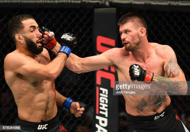 Tim Means punches Belal Muhammad in their welterweight bout during the UFC Fight Night event inside the Qudos Bank Arena on November 19 2017 in...