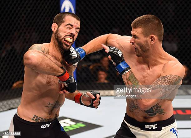 Tim Means punches Matt Brown in their welterweight fight during the UFC 189 event inside MGM Grand Garden Arena on July 11 2015 in Las Vegas Nevada