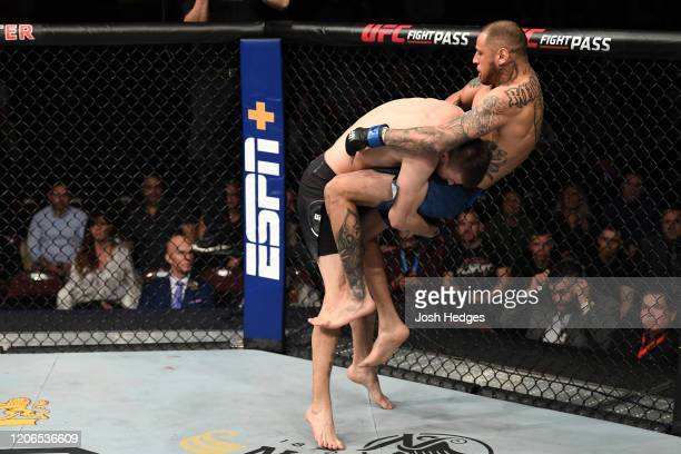 Tim Means takes down Daniel Rodriguez in their welterweight bout during the UFC Fight Night event at Santa Ana Star Center on February 15, 2020 in...