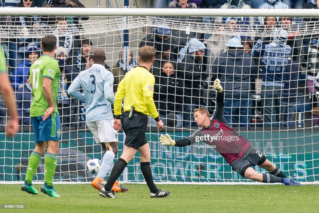 Tim Melia #29 of Sporting Kansas City fails to block the shot on goal by Cristian Roldan #7 of Seattle Sounders during the second half on April 15, 2018 at Children's Mercy Park in Kansas City, Kansas.