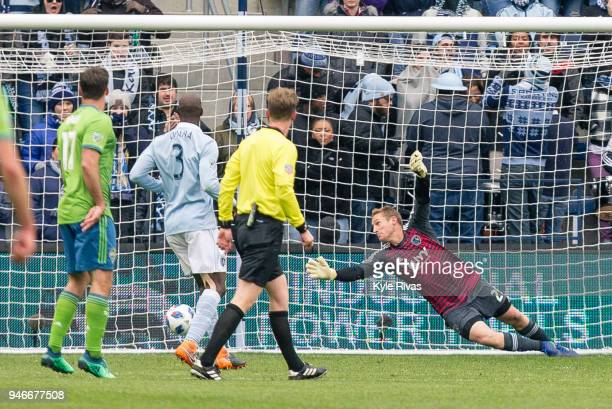 Tim Melia of Sporting Kansas City fails to block the shot on goal by Cristian Roldan of Seattle Sounders during the second half on April 15 2018 at...