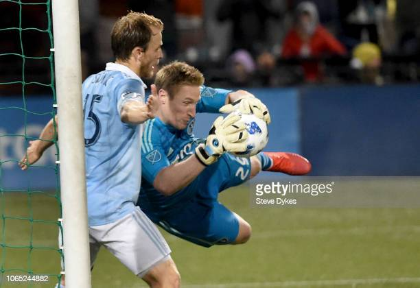Tim Melia of Sporting Kansas City makes a save on a shot as Seth Sinovic backs him up during the second half of the match against the Portland...
