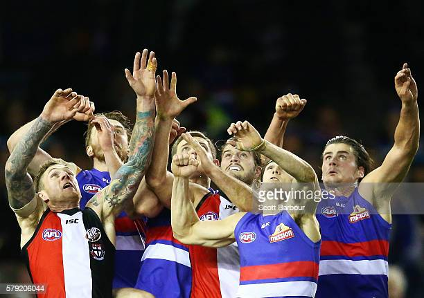 Tim Membrey , Nick Riewoldt and Maverick Weller of the Saints compete for the ball with Easton Wood and Tom Boyd of the Bulldogs during the round 18...