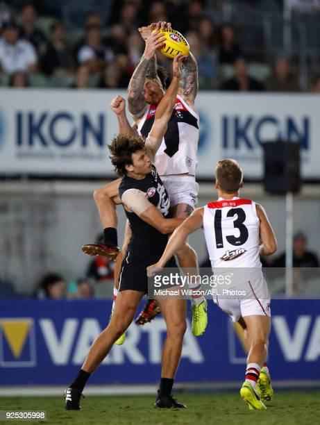 Tim Membrey of the Saints attempts to mark over Caleb Marchbank of the Blues during the AFL 2018 JLT Community Series match between the Carlton Blues...