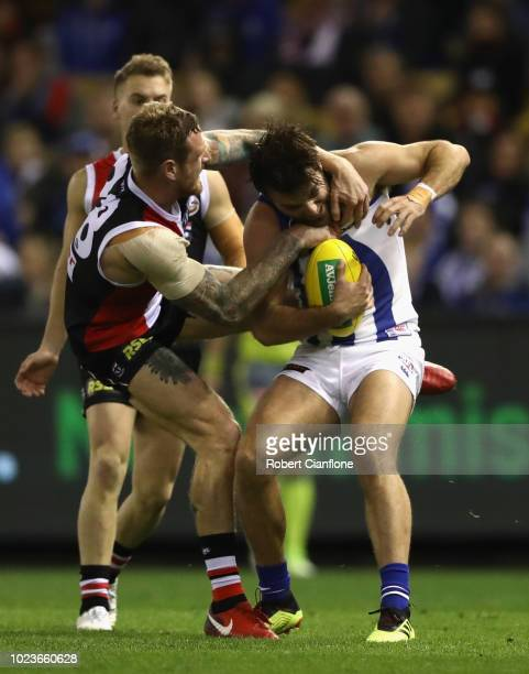 Tim Membrey of the Saints challenges Luke McDonald of the Kangaroos during the round 23 AFL match between the St Kilda Saints and the North Melbourne...