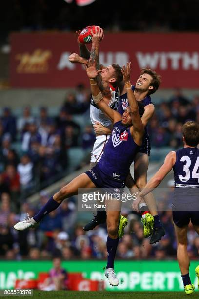 Tim Membrey of the Saints contests a mark against Michael Johnson and Joel Hamling of the Dockers during the round 15 AFL match between the Fremantle...