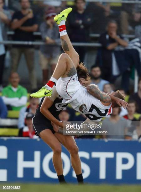 Tim Membrey of the Saints flies over Caleb Marchbank of the Blues during the AFL 2018 JLT Community Series match between the Carlton Blues and the St...