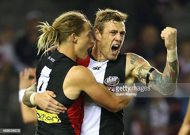 Tim Membrey of the Saints is congratulated by Eli Templeton after kicking a goal during the round one AFL match between the St Kilda Saints and the...