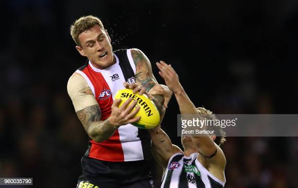 Tim Membrey of the Saints marks the ball ahead of Sam Murray of the Magpies during the round nine AFL match between the St Kilda Saints and the...