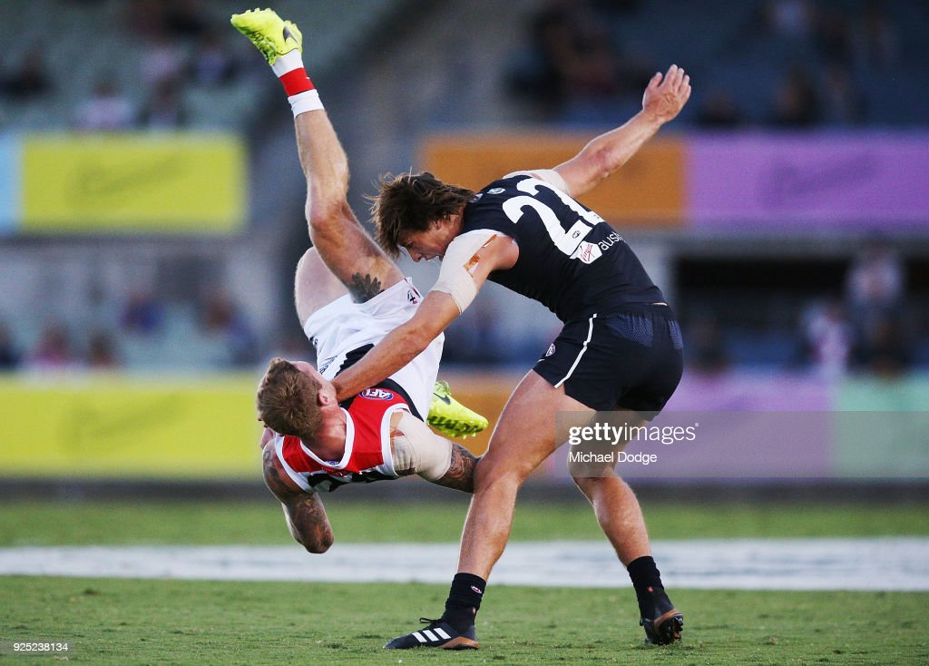 Tim Membrey of the Saints tumbles over Caleb Marchbank of the Blues during the JLT Community Series AFL match between the Carlton Blues and the St Kilda Saints at Ikon Park on February 28, 2018 in Melbourne, Australia.