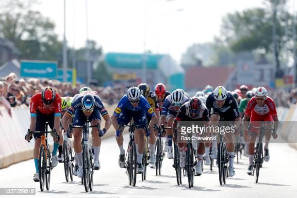 Tim Merlier of Belgium and Team Alpecin-Fenix, sprint to win ahead of Phil Bauhaus Germany and Team Bahrain Victorious, Fernando Gaviria Rendon of...
