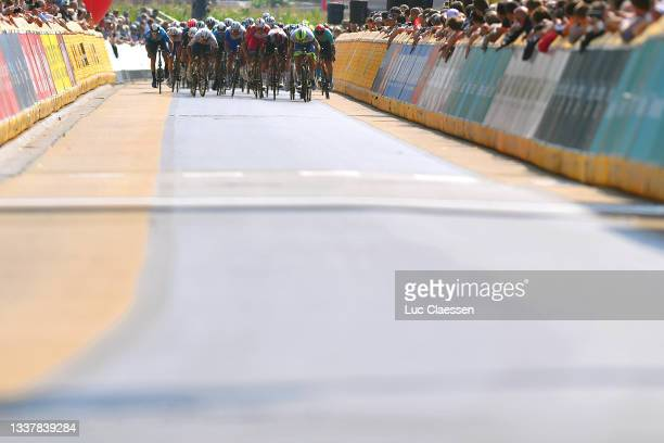 Tim Merlier of Belgium and Team Alpecin-Fenix sprints to win ahead of Mads Pedersen of Denmark and Team Trek - Segafredo, Boy Van Poppel of...