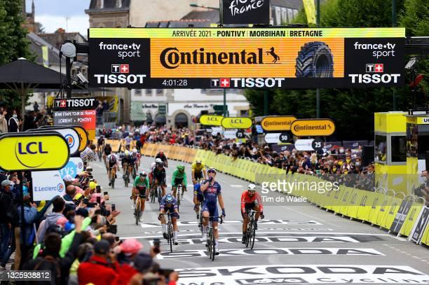 Tim Merlier of Belgium and Team Alpecin-Fenix stage winner celebrates at arrival, Jasper Philipsen of Belgium and Team Alpecin-Fenix, Nacer Bouhanni...