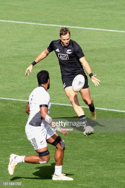 Tim Mikkelson kicks the ball during the match between the All Blacks Sevens Black and All Blacks Sevens White at Sky Stadium, on April 11 in...