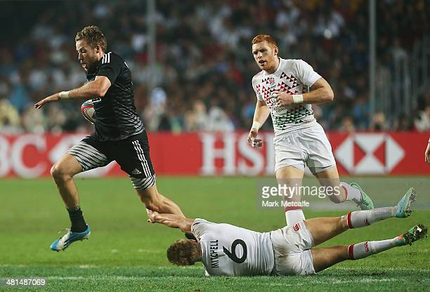 Tim Mikkelson of New Zealand evades the tackle of Tom Mitchell of England to score a try during the Cup final match between New Zealand and England...