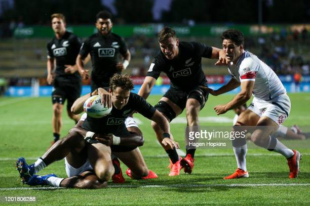 Tim Mikkelson of New Zealand scores a try in the tackle of Matai Leuta of the USA during the match between New Zealand and USA at the 2020 HSBC...