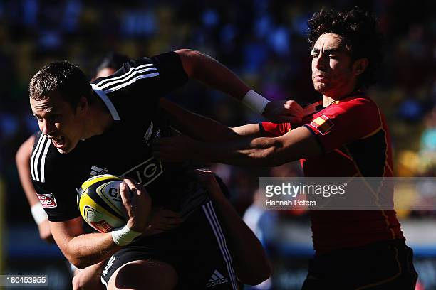 Tim Mikkelson of the All Blacks Sevens makes a break during the Pool A match between New Zealand and Portugal during the 2013 Wellington Sevens at...
