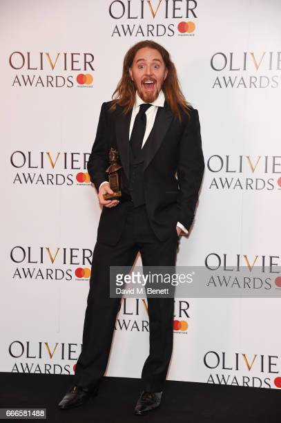 "Tim Minchin, accepting the Best New Musical award for ""Groundhog Day"", poses in the winners room at The Olivier Awards 2017 at Royal Albert Hall on..."