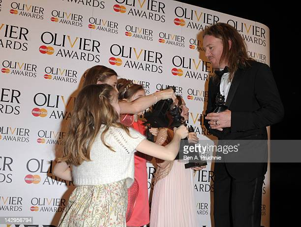 Tim Minchin greets Sophia Kiely Eleanor Worthington Cox Kerry Ingram and Cleo Demetriou winners of Best Actress in a Musical for Matilda the Musical...